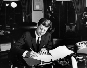 JFK signing bill